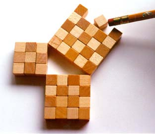 Pythagorean right triangle made from squares of wooden cubes: three by three, four by four, five by five.